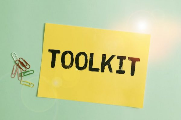 Word writing text Toolkit. Business concept for set of tools kept in a bag or box and used for a particular purpose Plain cardboard and writing equipment placed above pastel colour backdrop.