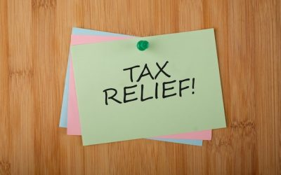 Tax Relief! written on green paper note